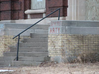 graffiti on the front of the gymnasium with names of units stationed at Ft. Snelling in the first half of the 20th century